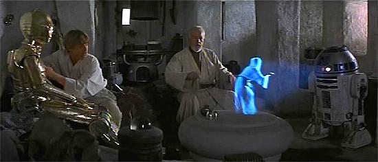 R2-D2 spielt mit seinem Holoprojektor einer Nachricht von Leia ab